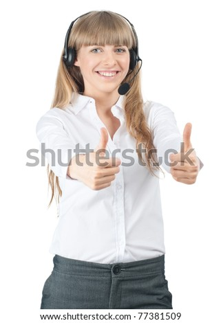 Portrait of a pretty young female call center employee wearing a headset and showing thumbs up, against white background - stock photo