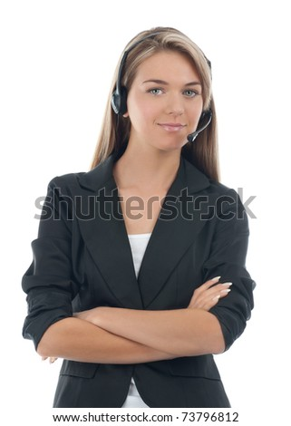 Portrait of a pretty young female call center employee wearing a headset with crossed arms, against white background - stock photo