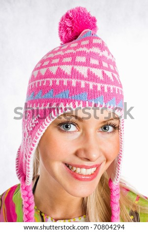 Portrait of a pretty young female wearing a winter cap - stock photo