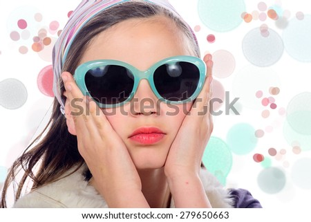 portrait of a pretty young girl with  blue sunglasses - stock photo