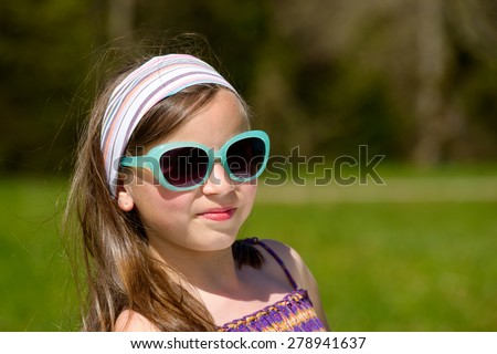 portrait of a pretty young girl with sunglasses - stock photo