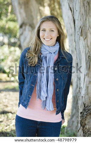 Portrait of a Pretty Young Woman In a Park  Smiling To Camera - stock photo