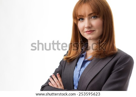 portrait of a professional looking businesswoman wearing a suit  - stock photo