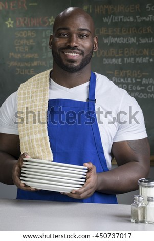 Portrait of a proud, male restaurant worker - stock photo