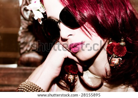portrait of a red hair woman with sunglasses - stock photo