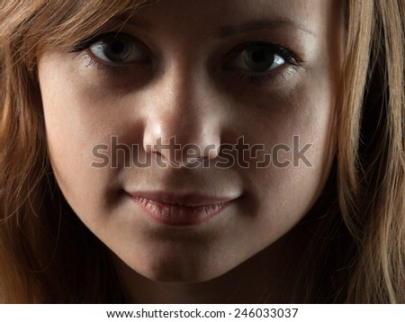 Portrait of a redheaded girl. Close up - stock photo