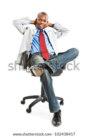Portrait of a relaxed businessman sitting on a chair - stock photo