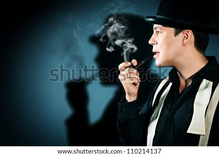 Portrait of a retro detective in pot hat smoking his pipe. - stock photo
