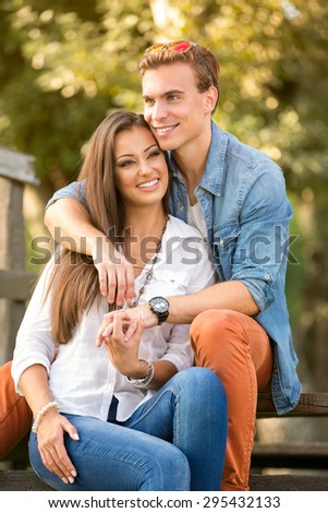 Portrait of a romantic couple enjoying themselves in the park - stock photo