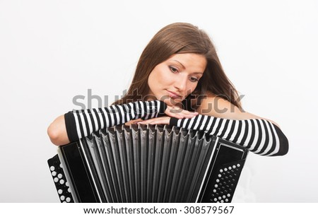 Portrait of a sad girl with the Russian bayan (button accordion) - stock photo