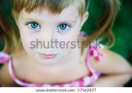 Portrait of a sad liitle girl close-up - stock photo