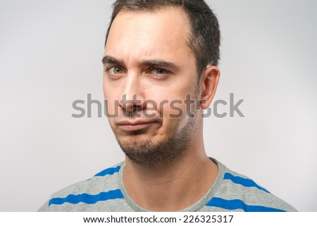 Portrait of a sad man - stock photo