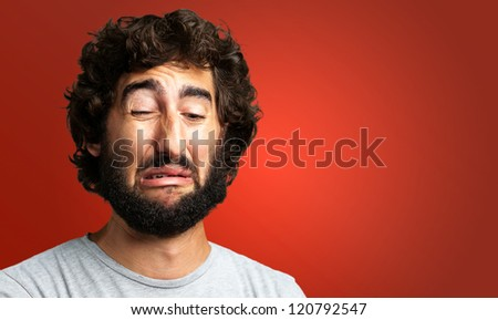 Portrait Of A Sad Man against a red background - stock photo