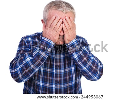 Portrait of a sad man covering his face with hands over white background - stock photo