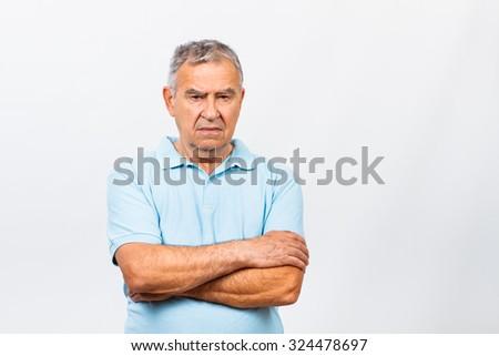 Portrait of a sad senior man.Sad senior man - stock photo