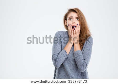 Portrait of a scared woman looking at camera isolated on a white background - stock photo