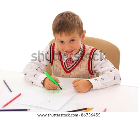 Portrait of a school boy doing homework at his desk, isolated on white background - stock photo