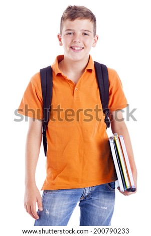 Portrait of a school boy with backpack holding notebooks, isolated on white background - stock photo