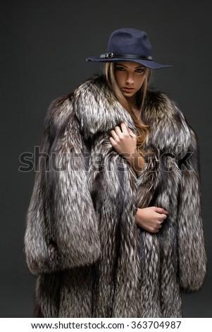 Portrait of a seductive lady in fur coat  - stock photo