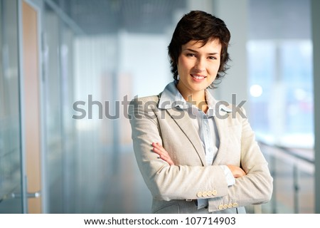 Portrait of a self-confident business lady with a charming smile - stock photo