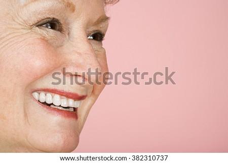 Portrait of a senior adult woman - stock photo