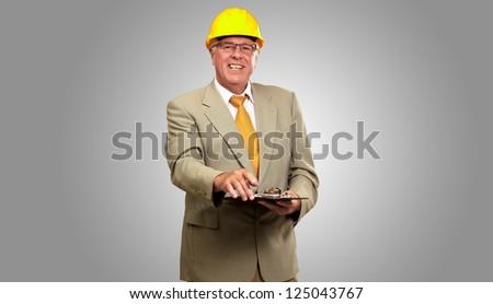 Portrait Of A Senior Architect On gray Background - stock photo