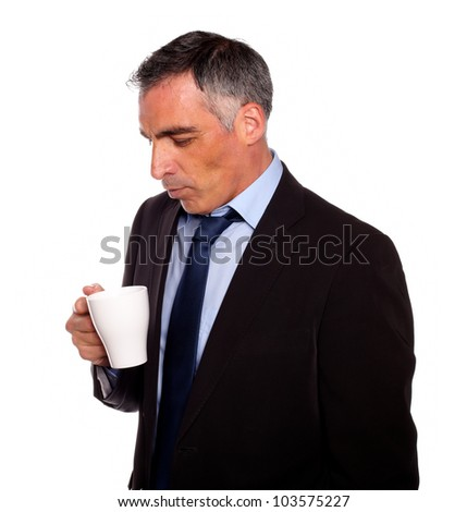 Portrait of a senior businessman looking to a empty mug on isolated background - stock photo
