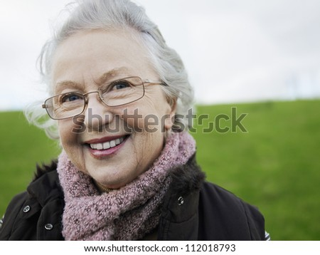 Portrait of a senior Caucasian woman smiling - stock photo