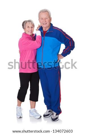 Portrait Of A Senior Couple Exercising On White Background - stock photo