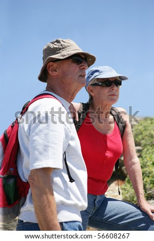 Portrait of a senior couple of hikers - stock photo
