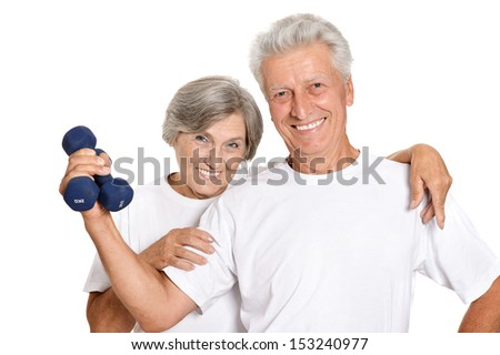 Portrait Of A Senior Couple Standing With Dumbbells On White Background - stock photo