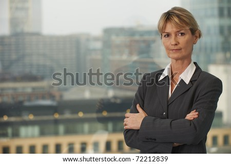 Portrait of a senior executive by a window looking at camera with space for copy - stock photo