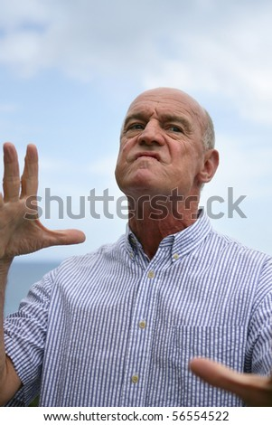 Portrait of a senior man angry - stock photo