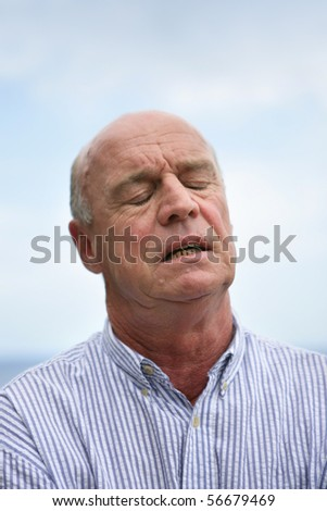 Portrait of a senior man annoyed - stock photo