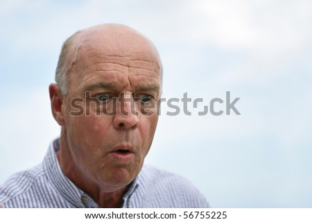 Portrait of a senior man astonished - stock photo
