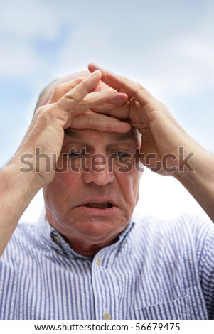 Portrait of a senior man concentrating - stock photo