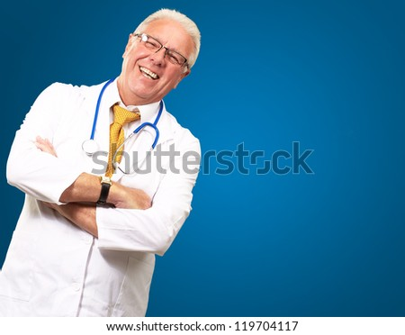 Portrait Of A Senior Man Doctor Isolated On Blue Background - stock photo