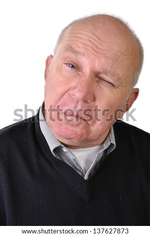portrait of a senior man making faces - stock photo