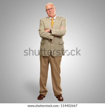 Portrait Of A Senior Man On Gray Background - stock photo