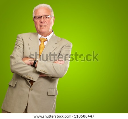 Portrait Of A Senior Man On Green Background - stock photo