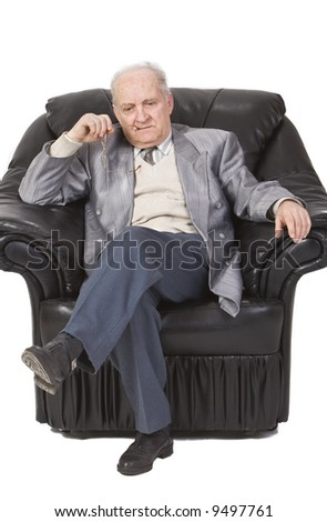 Portrait of a senior man sitting in an armchair and thinking deeply. - stock photo