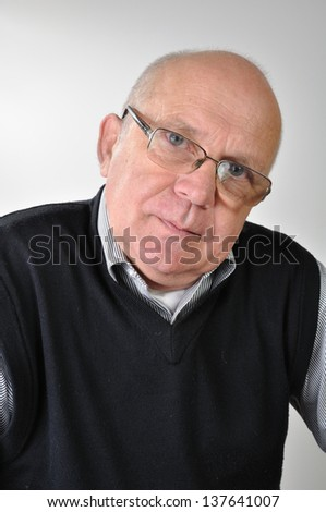 portrait of a senior man with glasses - stock photo