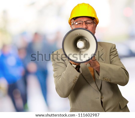 Portrait Of A Senior Man With Megaphone, Background - stock photo