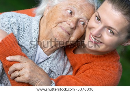Portrait of a senior woman and her granddaughter - stock photo