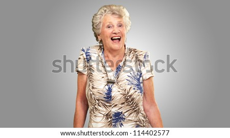 Portrait Of A Senior Woman Happy On gray Background - stock photo
