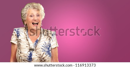 Portrait Of A Senior Woman Happy On Pink Background - stock photo