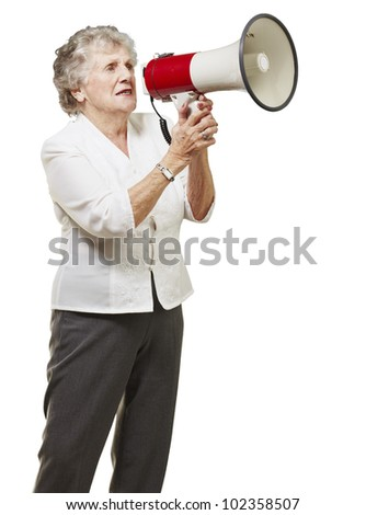 portrait of a senior woman holding a megaphone over a white background - stock photo
