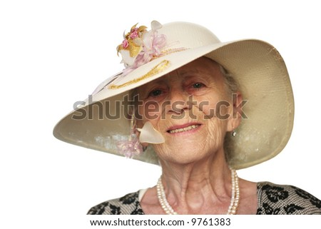 Portrait of a senior woman in retro hat, isolated on white. - stock photo