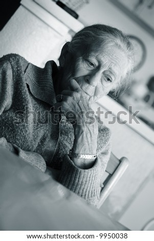 Portrait of a senior woman indoors. - stock photo