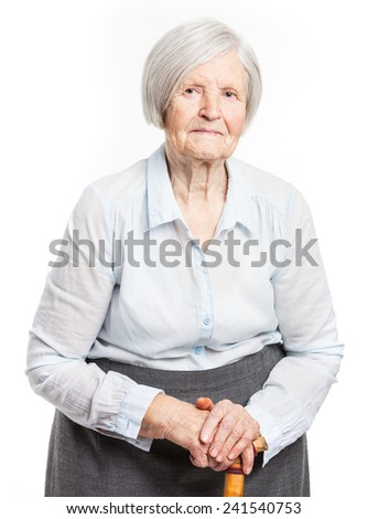 Portrait of a senior woman looking at the camera. Over white background.  - stock photo
